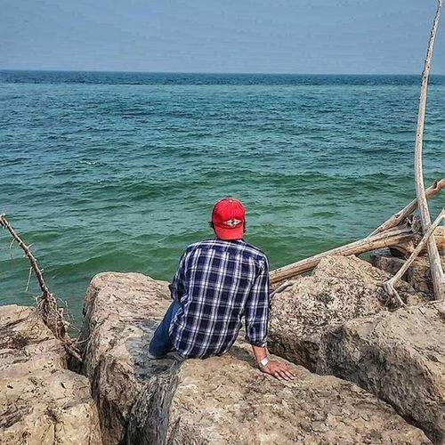 My MCM looking out at the beautiful blue waters of Lake Michigan. We could sit out on those rocks forever. Lake Michigan TravelWI Myfavoriteview
