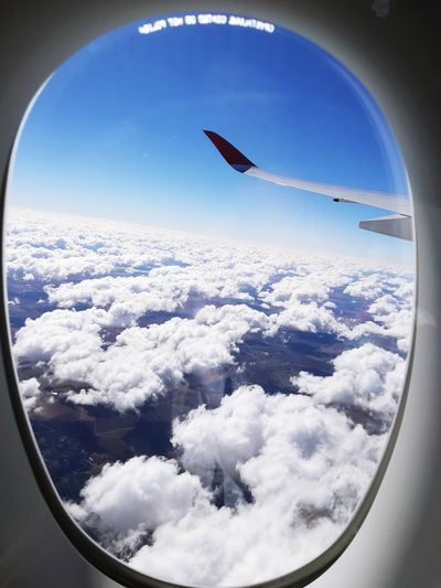 EyeEmNewHere Out The Window  Over The Rainbow Clouds And Sky Clouds Blue Sky Over The Clouds Leaving Adventures Travel Photography Travel EyeEm Selects #EyeEmNewHere Flying Commercial Airplane Air Vehicle Aerial View Plane Mid-air Aircraft Wing Window Sky Aeroplane Airplane Wing Flight The Traveler - 2018 EyeEm Awards