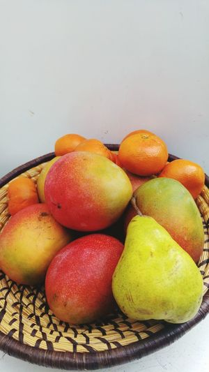 Fruit Healthy Eating Food Food And Drink Freshness Indoors  No People Healthy Lifestyle Close-up Day Mangoes Oranges Pear Basket Part Of Five A Day Beauty In Nature Fruits Photography