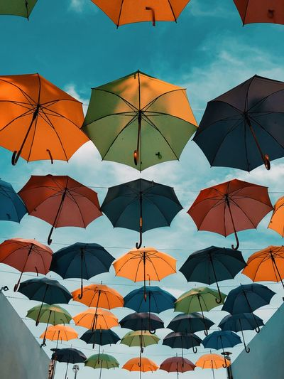 Umbrella Pattern Backgrounds No People Low Angle View Sky Protection Hanging Multi Colored Outdoors Cloud - Sky Full Frame Creativity Day Nature Close-up Security Sunlight Shape Ceiling