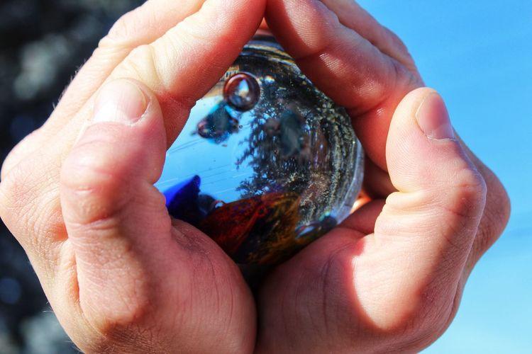 Close-up of hand holding globe