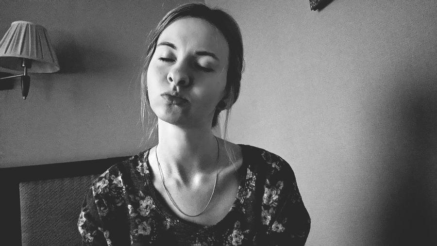Portrait of woman pouting
