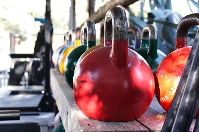 Kettlebells Exercise Equipment Lined Up Gym Crossfit Kettlebells Red Focus On Foreground Close-up Day No People Sport Multi Colored Outdoors In A Row Still Life Metal