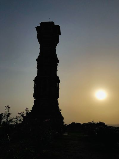 Low angle view of silhouette structure against sky during sunset