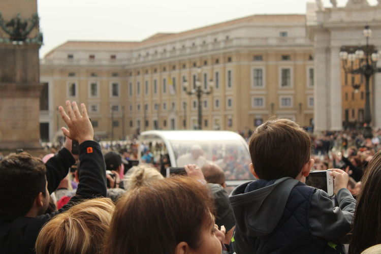 Group of people photographing the pope in the vatican