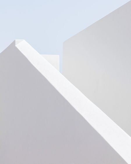 High angle view of white wall by building