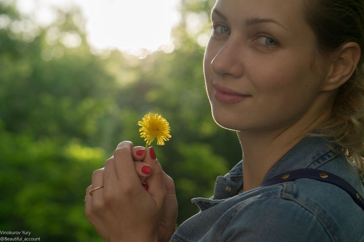 Casual Clothing Close-up Dandelion Day Flower Focus On Foreground Fragility Headshot Holding Human Face Leisure Activity Lifestyles Nature Outdoors Portrait Yellow