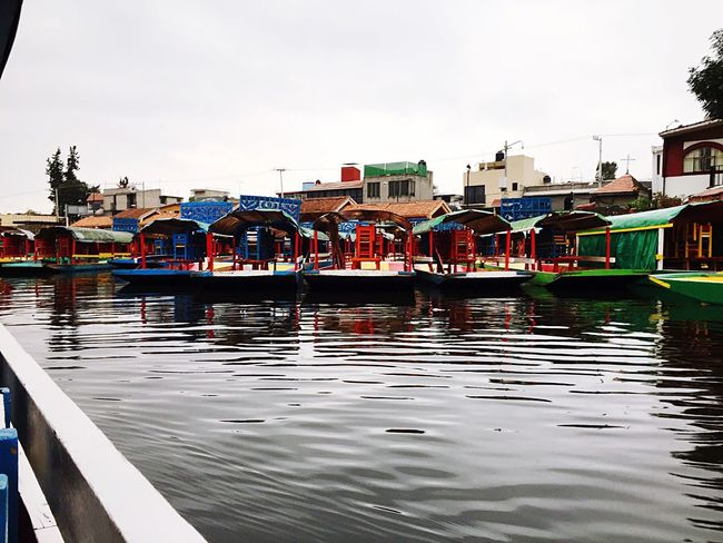 Building Exterior Reflection Water Transportation Built Structure Architecture Nautical Vessel Mode Of Transport Outdoors Waterfront Canal Moored Sky Day Trajineras Colorful EyeEmNewHere