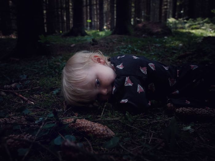 Magda in the forest Atmospheric Mood EyeEm Best Shots Perspective Portrait Exploration Child Fantasy Childhood Beauty In Nature Land Forest Nature Tree Plant Day Childhood Real People One Person WoodLand Outdoors Grass The Portraitist - 2018 EyeEm Awards