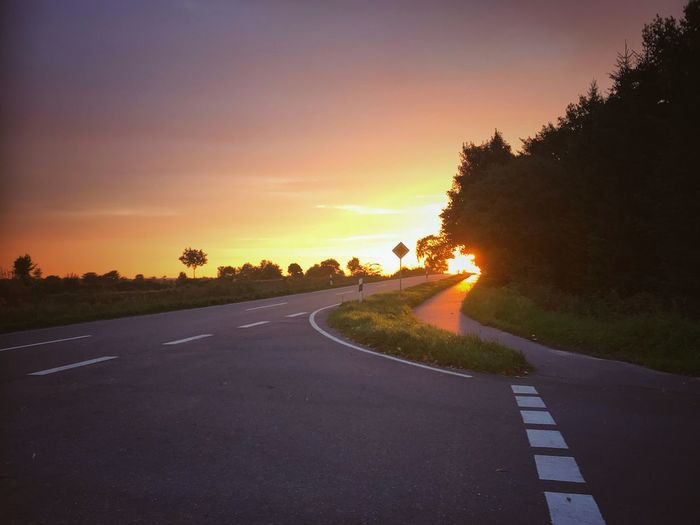 drive to work Road Sky Sunset Tree Direction Sign Transportation Scenics - Nature Nature Asphalt No People