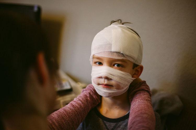Portrait of boy with bandage