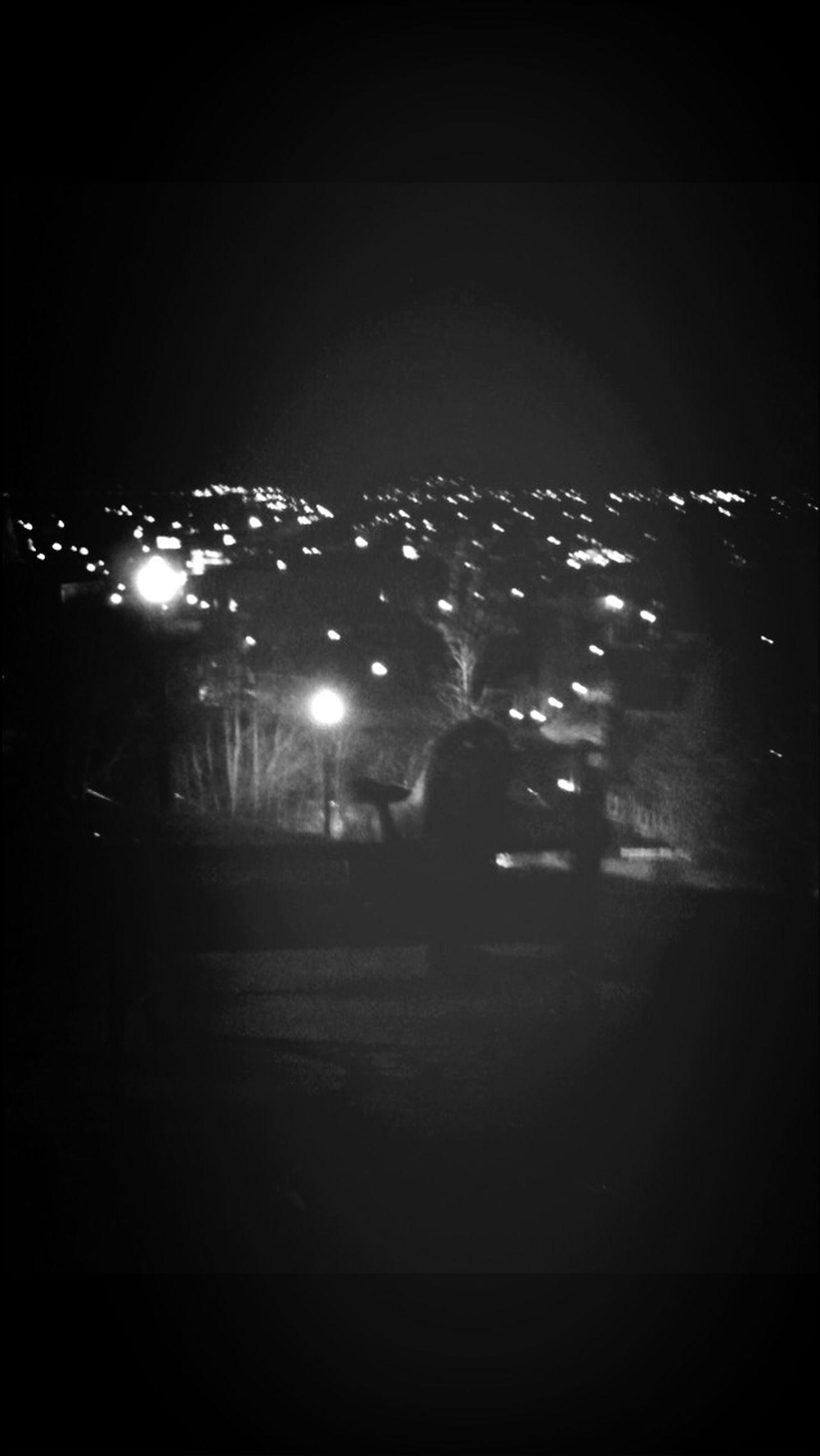 night, illuminated, dark, lifestyles, leisure activity, men, lighting equipment, copy space, building exterior, light - natural phenomenon, city, street, built structure, architecture, full length, unrecognizable person, standing, silhouette