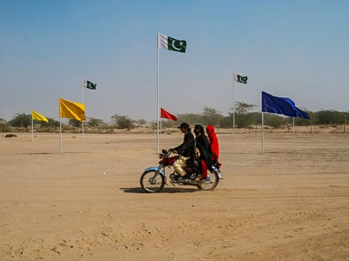 Flags, desert and a motorbike. The Places I've Been Today EyeEm Gallery Travel Getting Inspired Shootermag Desert Holiday Adventure Places Life In Motion