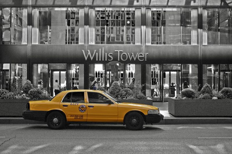 Chicago EyeEm Best Shots Taxi United States Willis Tower Architecture Building Exterior Built Structure Cab Car City Communication Day Land Vehicle Mode Of Transport No People Outdoors Transportation Urban Yellow