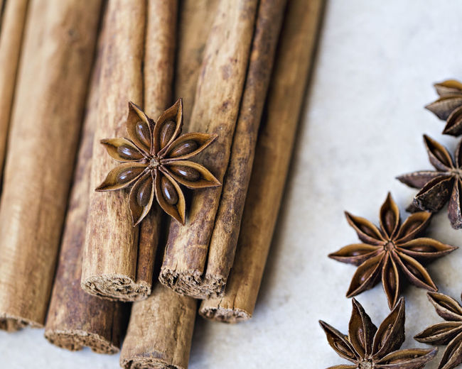 Close-up of cinnamons and star anise on table
