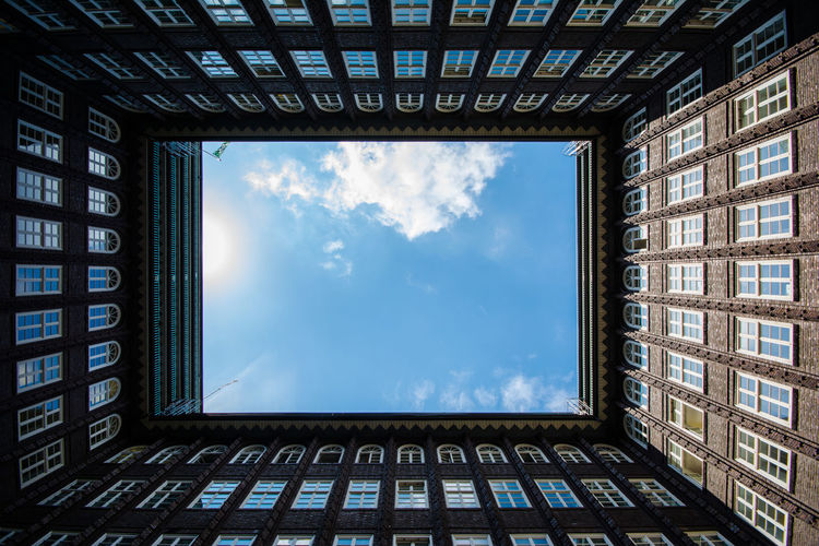 the open roof Architecture Sky Window Cloud - Sky Built Structure Nature Building Building Exterior Blue City Directly Below Shape Outdoors Low Angle View Cloudscape Geometric Shape Technology Looking At View Brick Building UNESCO World Heritage Site Chilehaus Hamburg Exceptional Photographs Architectural Column Symmetry EyeEm Best Shots The Architect - 2019 EyeEm Awards