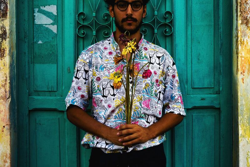 waiting EyeEm Best Shots EyeEmNewHere Selfportrait Self Portrait Photooftheday Urbanphotography Mexico Flower Portrait Standing Men Front View Looking At Camera Wood - Material Door Turquoise Colored Stilt House Flower Head Colorful Petal