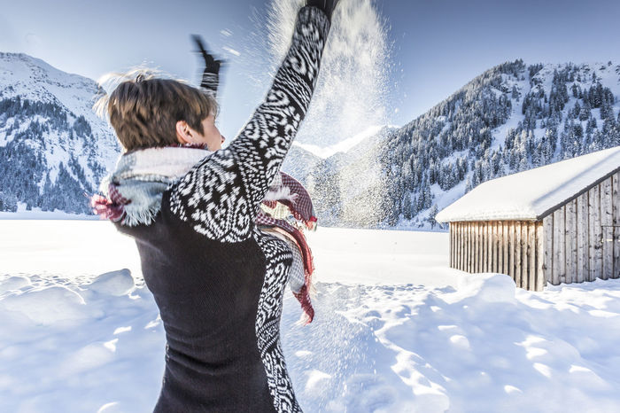 Woman enjoying winter landscape Allgäu Having Fun Hiking Holiday Recreation  Tannheimer Tal Tirol  Woman Bayern Beauty In Nature Bliss Hotel Joy Leisure Activity Lifestyles Mountain Range One Person Outdoors Snow Splashing Sunlight Vacations Vilsalpsee Warm Clothing Winter