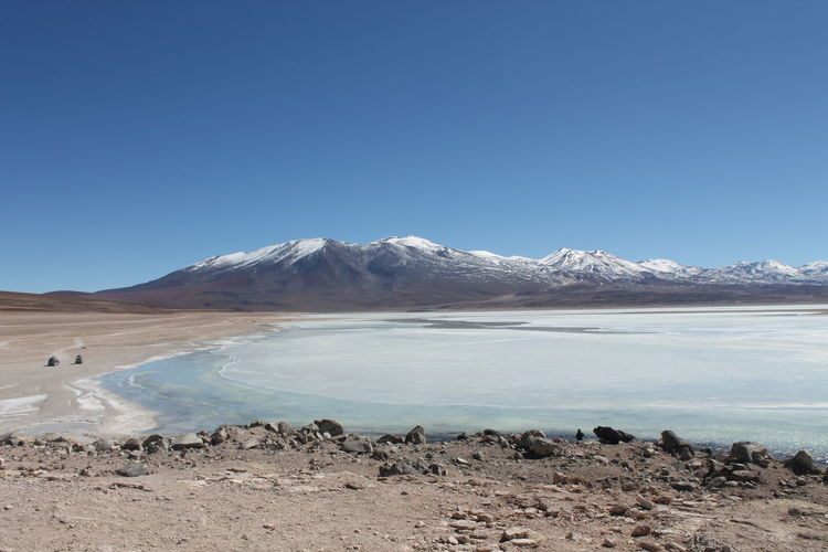 Lagoon and Mountain range Atacama Desert Chile Lagoon Mountain Mountain Peak Mountain Range Salt Flat Snowcapped Mountain Tranquil Scene Tranquility Water
