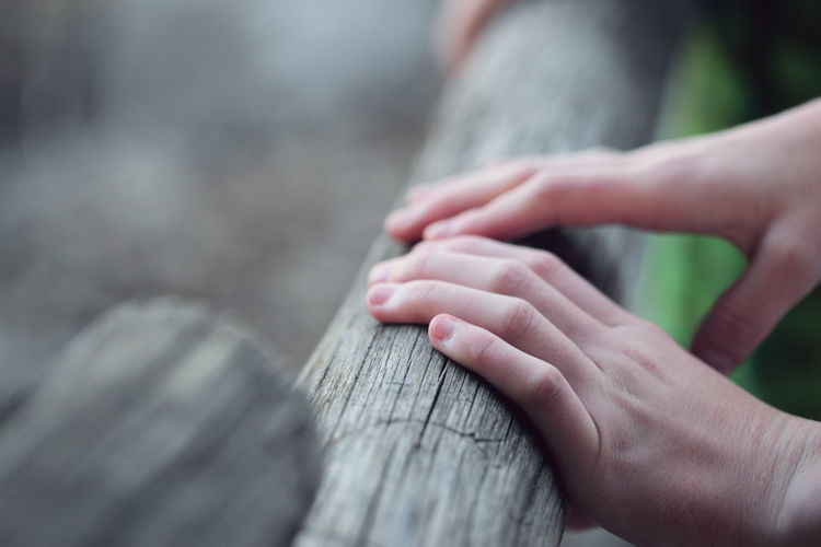 Close-up Day Fence Hands Human Body Part Human Hand Leisure Activity Lifestyles Outdoors People Real People Selective Focus Women Wood Wooden