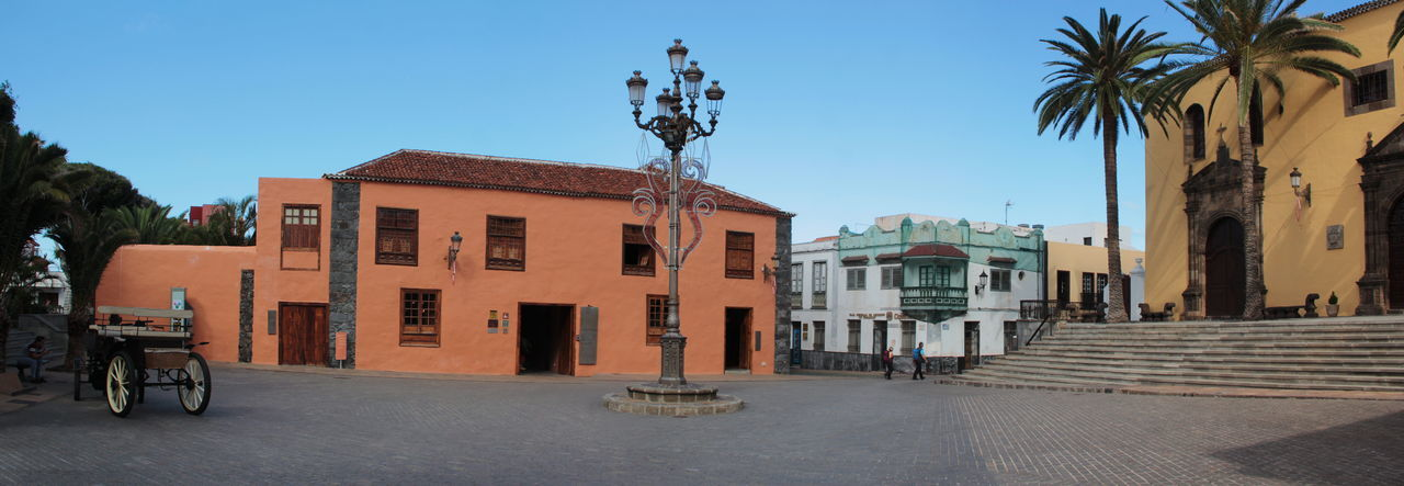 Architecture Building Exterior Built Structure City Clear Sky Day Garachico Marketplace Medieval Architecture No People Outdoors Palm Tree Panorama Panoramic Photography Places Sky Tenerife Town Tree