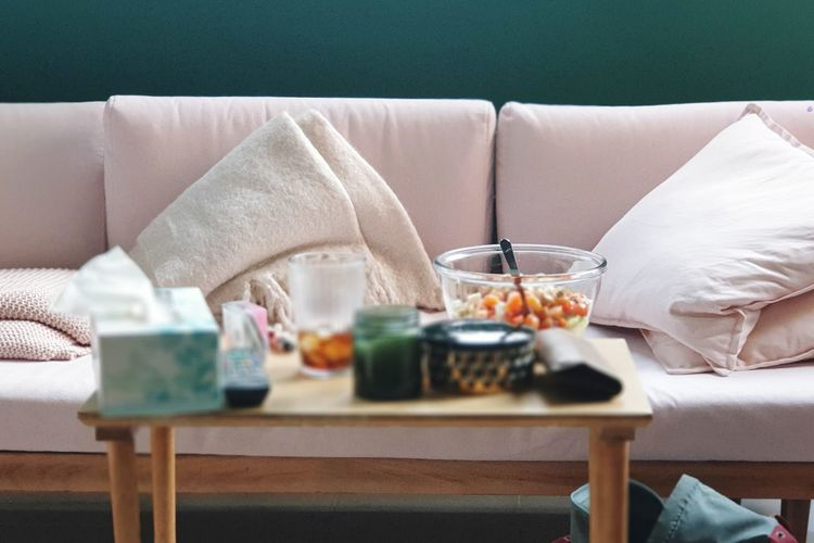 Midsection of woman relaxing on table at home