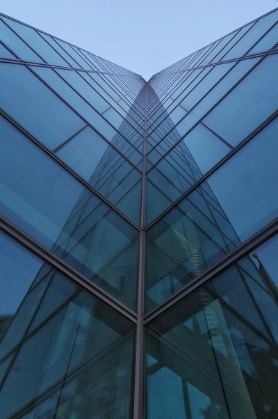 A breakneck 60 stories plus. Built Structure Low Angle View Modern Architecture Building Exterior Day Skyscraper Sky Outdoors Reflection Glass And Metal The Way Up Photography