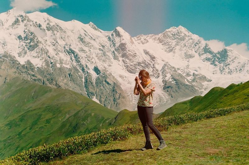 Mountain One Person Mountain Range Hiking Landscape Beauty In Nature Healthy Lifestyle Full Length Adults Only Green Color One Woman Only Snow Nature Young Adult Grass Outdoors People Sport Scenics