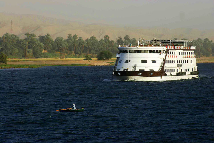 Past and present meet Water Nautical Vessel Mode Of Transportation Nature River Nile River Cruise Ship Rowing Boat Large Ship One Figure