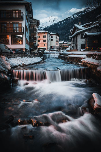 Water flowing over buildings during winter