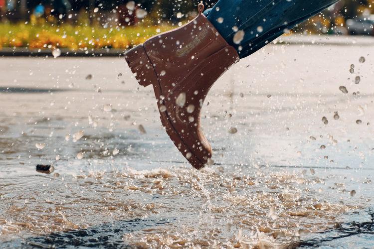 Low section of man splashing water