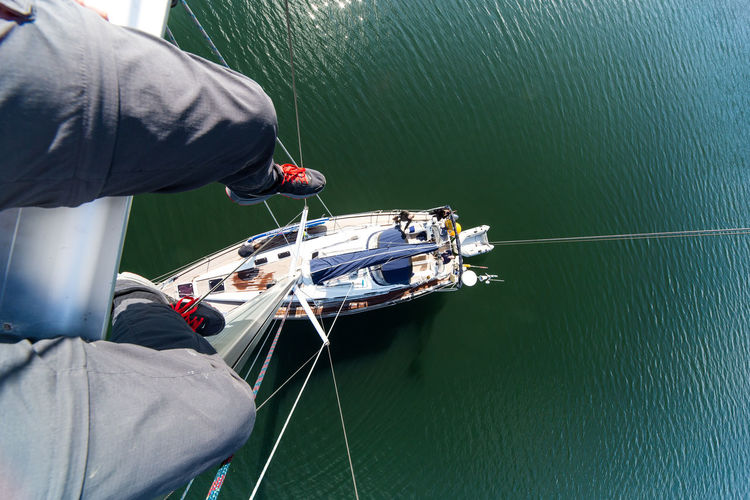 High angle personal perspective of the mast of a sailing boat