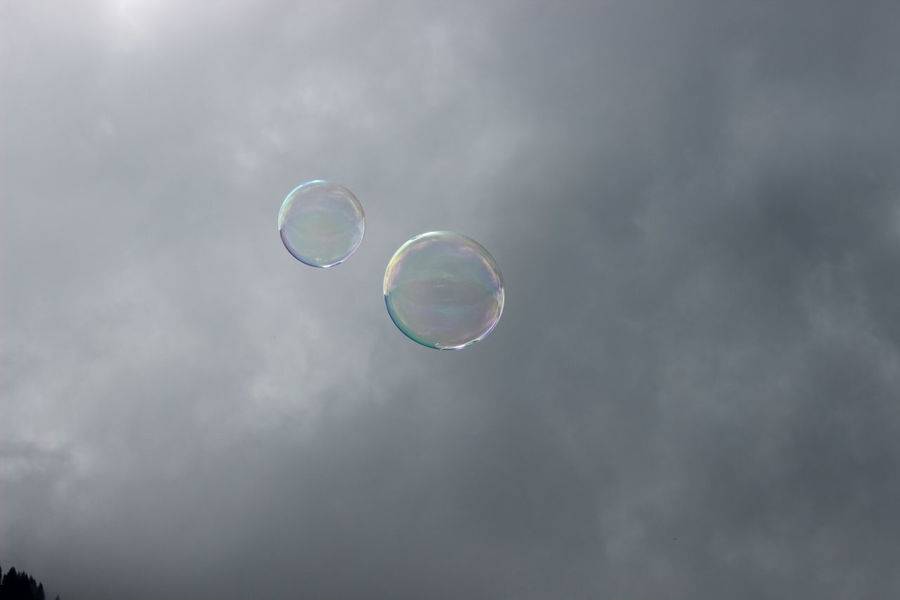Dreams & Bubbles flying high Beauty In Nature Blowing Bubble Bubble Wand Cloud - Sky Day Double Rainbow Flying Fragility Low Angle View Mid-air Nature No People Outdoors Rainbow Sky Soap Sud Spectrum
