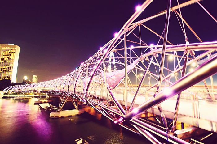 Bridge at MBS. Bridge - Man Made Structure Illuminated City Ferris Wheel Travel Destinations Architecture Night Built Structure Connection Outdoors Rollercoaster Cityscape Sky Amusement Park No People Water