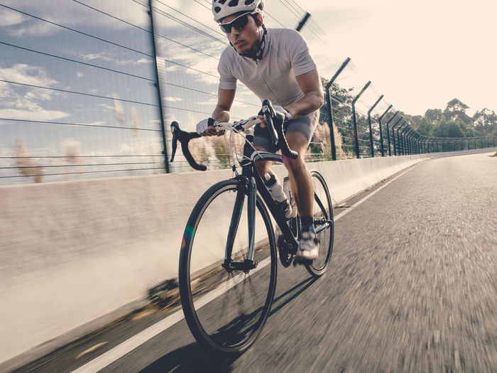 Cyclist man on the road Biking Cyclist Man Sportsman Activity Bicycle Blurred Motion Bycicle Photography Cycling Effort Healthy Lifestyle Lifestyle Photography Lifestyles Men Mode Of Transportation Motion One Man Only One Person Racing Bike Ride Riding Road Speed Sport Transportation