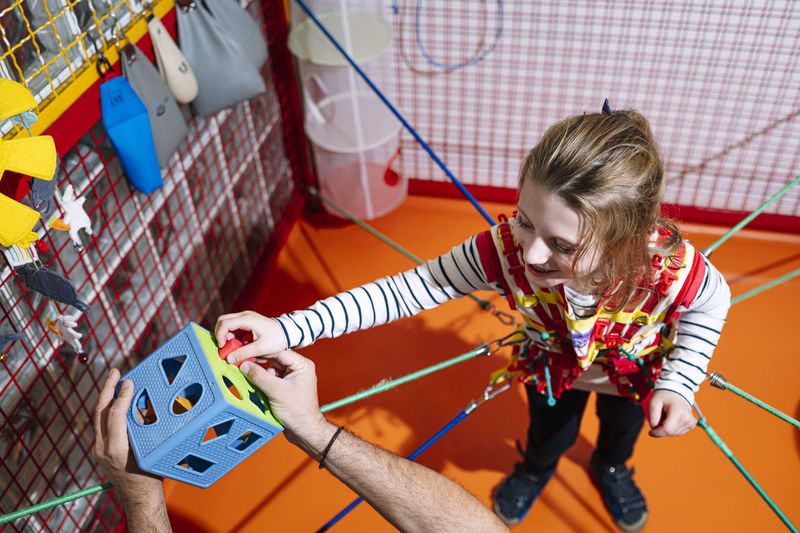 High angle view of girl playing with rope