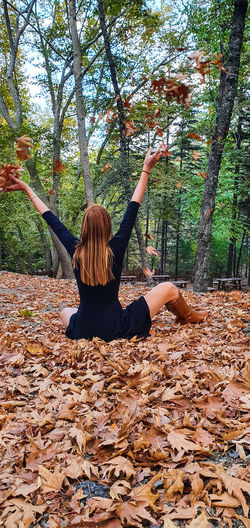 Rear view of woman in park during autumn