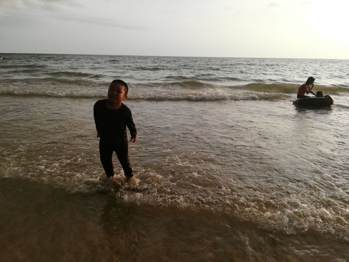 Children enjoy on summer trip 2019,หาดเจ้าหลาว Achi2019 Water Sea Horizon Horizon Over Water Beach Sky Land Real People Leisure Activity Beauty In Nature Lifestyles Motion Nature People Scenics - Nature Wave Holiday Vacations Waterfront Outdoors