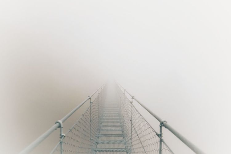 Rope bridge during foggy weather
