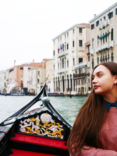 Portrait of young woman in boat on canal