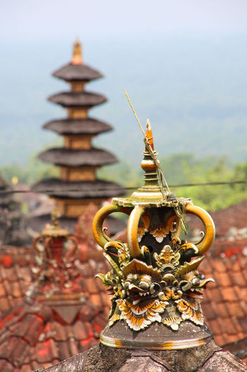 Roof of a Balinese temple with the ornament of the Balinese religion - Besakih/Indonesia Architecture Bali, Indonesia Balinese Culture Besakih Temple Cultures Day Gold Gold Colored Outdoors Religion Spirituality Temple