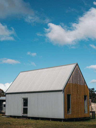 Exterior of house on field against sky