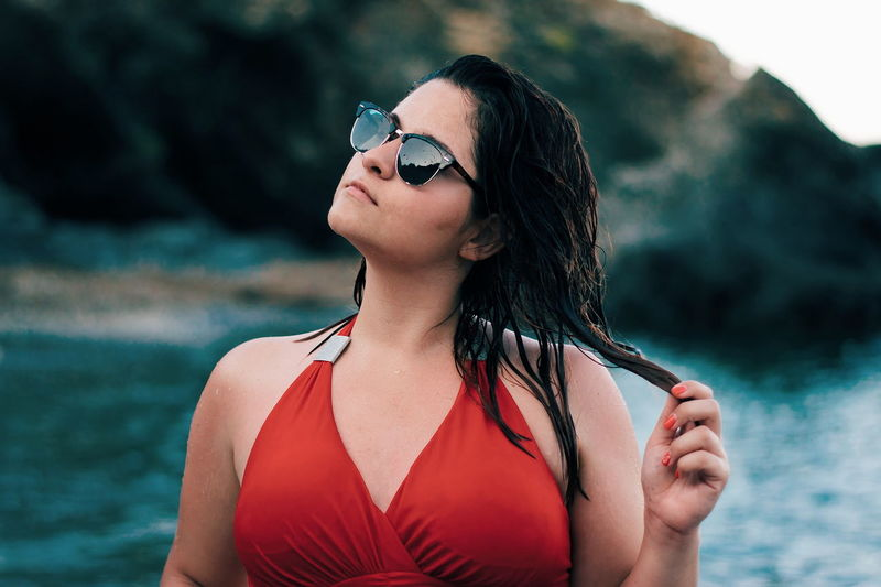 EyeEmNewHere One Woman Only Only Women Adult Adults Only One Person Water Sunglasses People Fashion Summer Red Young Adult Wet Beautiful People Beauty Arts Culture And Entertainment Portrait One Young Woman Only Long Hair Women