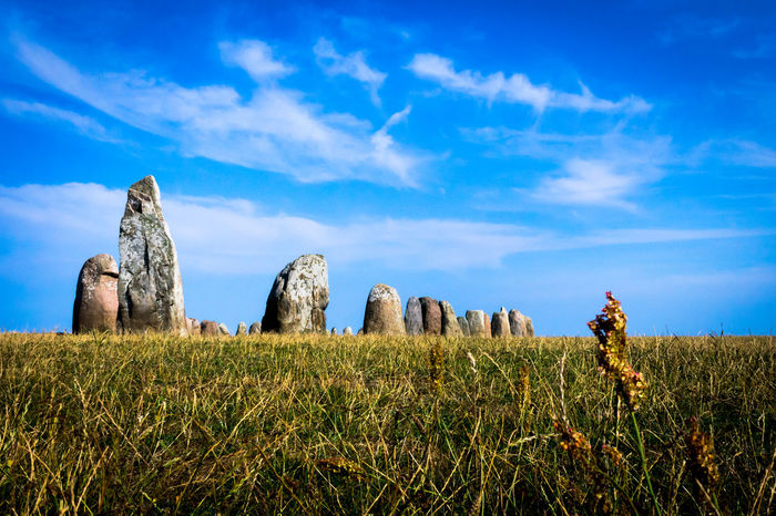 Ales Stenar Ancient Ancient Ancient Civilization Beauty In Nature Blue Civilization Cloud - Sky Day Environment Field Grass History Land Landmark Landscape Nature No People Plant Rock Scenics - Nature Sky The Past Tranquil Scene Tranquility