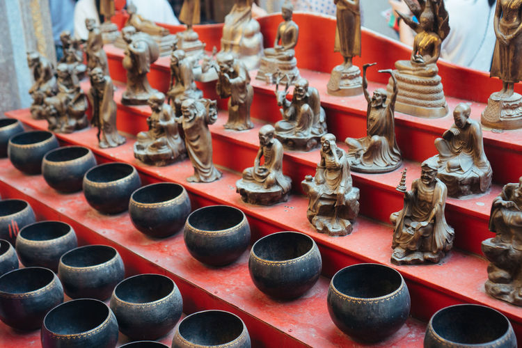Art And Craft Large Group Of Objects Abundance Choice Arrangement No People Creativity Retail  Craft Still Life Variation High Angle View Ceramics For Sale Metal Pottery In A Row Indoors  Market Representation Order Retail Display Antique