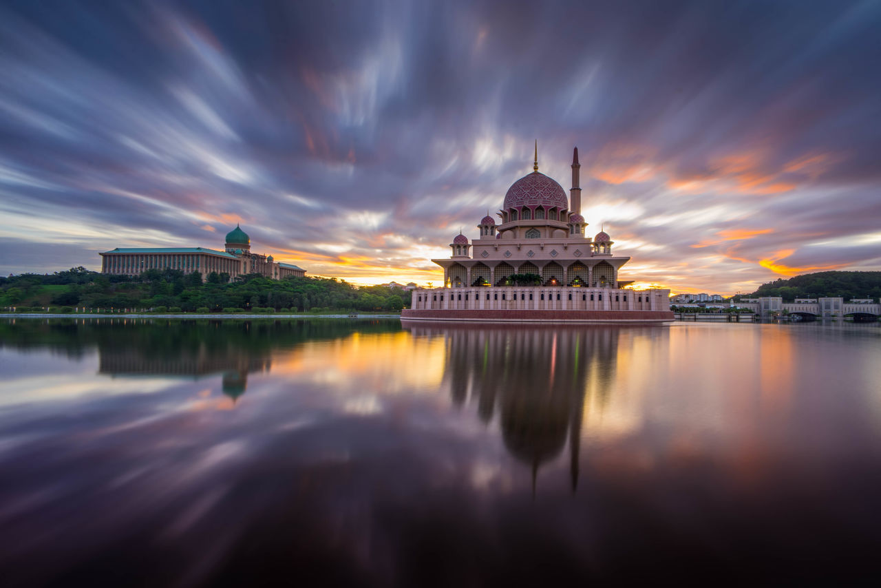 architecture, built structure, reflection, dome, building exterior, cloud - sky, religion, water, sky, spirituality, travel destinations, place of worship, waterfront, history, sunset, no people, outdoors, nature, day
