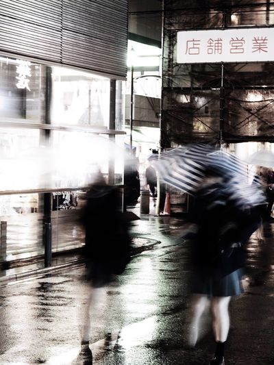It rains in spring☔️ Olympus OM-D E-M5 Mk.II Tokyo Street Photography Umbrella Motion Motion Blur Young Women School Girl Night Blurred Motion Walking Motion Real People Large Group Of People People