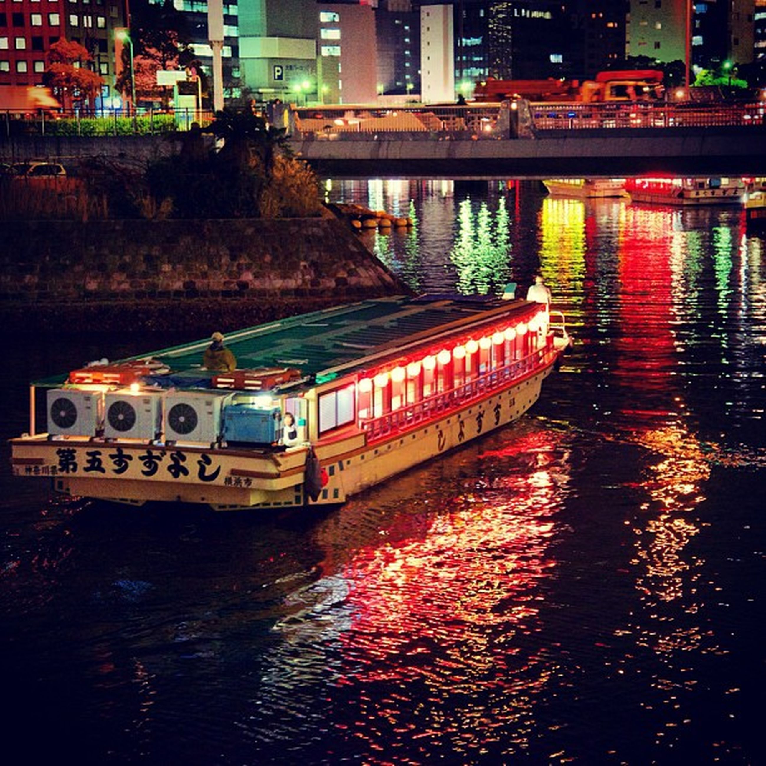 architecture, built structure, water, building exterior, transportation, mode of transport, waterfront, city, river, nautical vessel, high angle view, bridge - man made structure, boat, illuminated, night, reflection, canal, travel, connection, city life