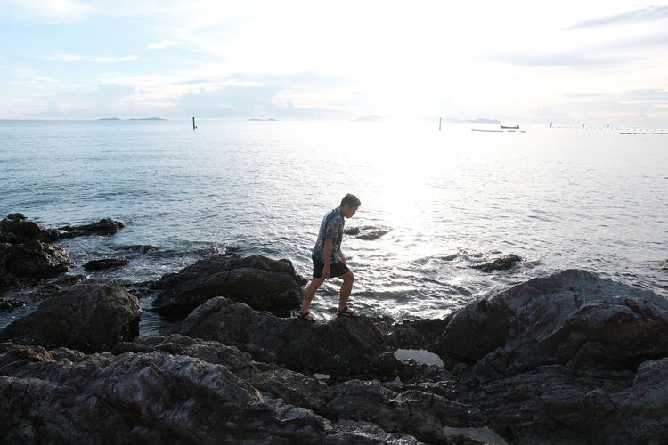 sea Water Rock Sea Solid Rock - Object Sky One Person Beauty In Nature Scenics - Nature Leisure Activity Real People Horizon Nature Full Length Lifestyles Day Side View Tranquility Horizon Over Water Outdoors Looking At View Travling Travel Photography