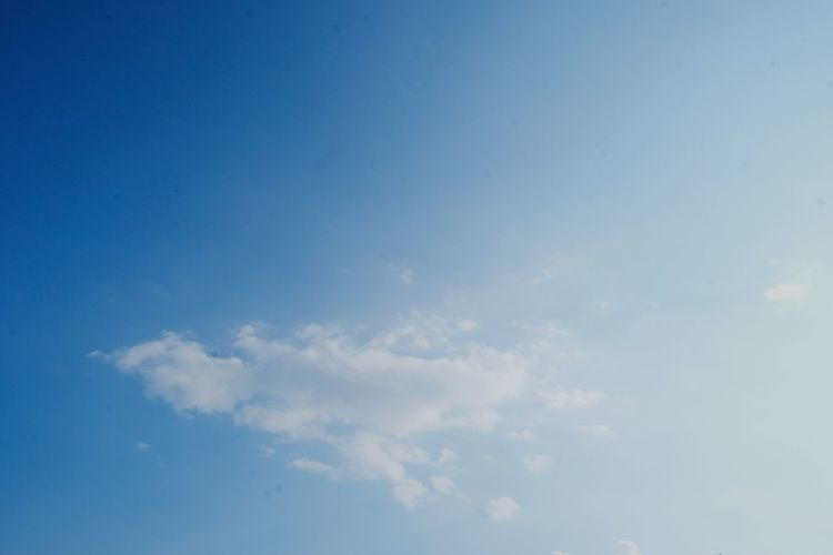 Blue sky, a few